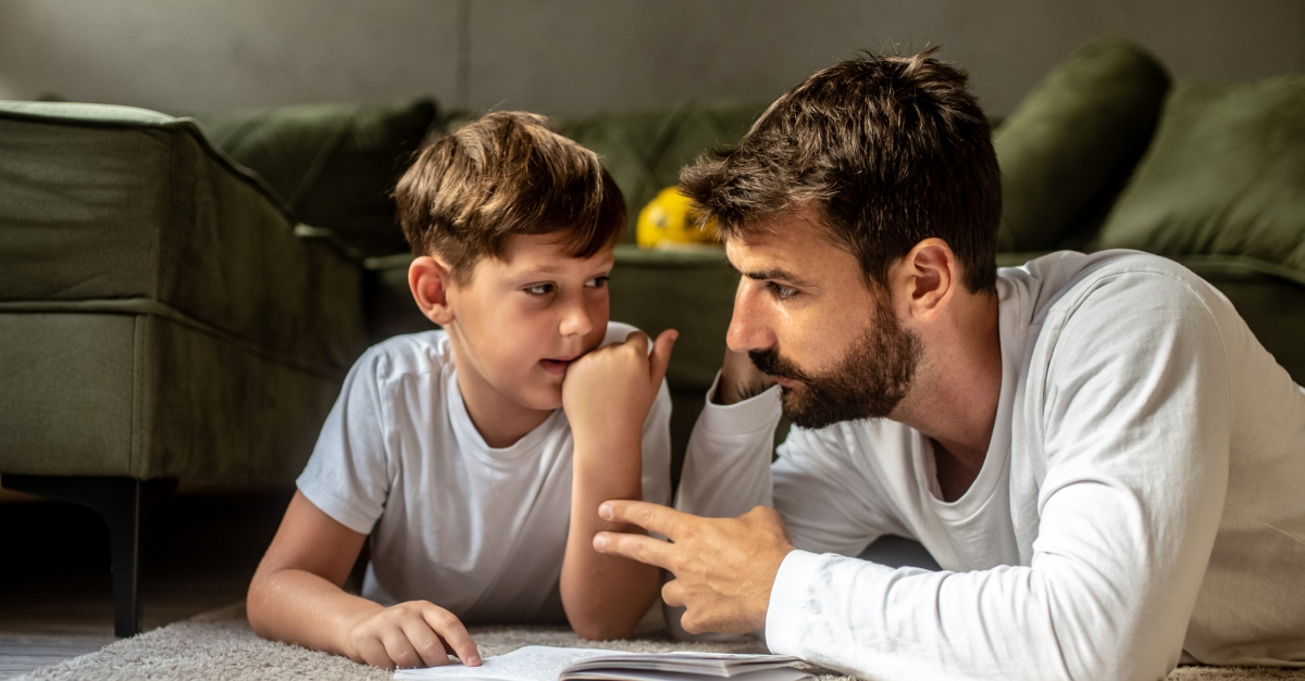 son and dad reading having a conversation