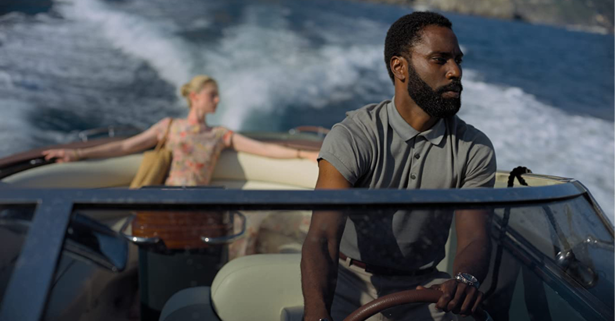 John David Washington and Elizabeth Debicki on a speed boat