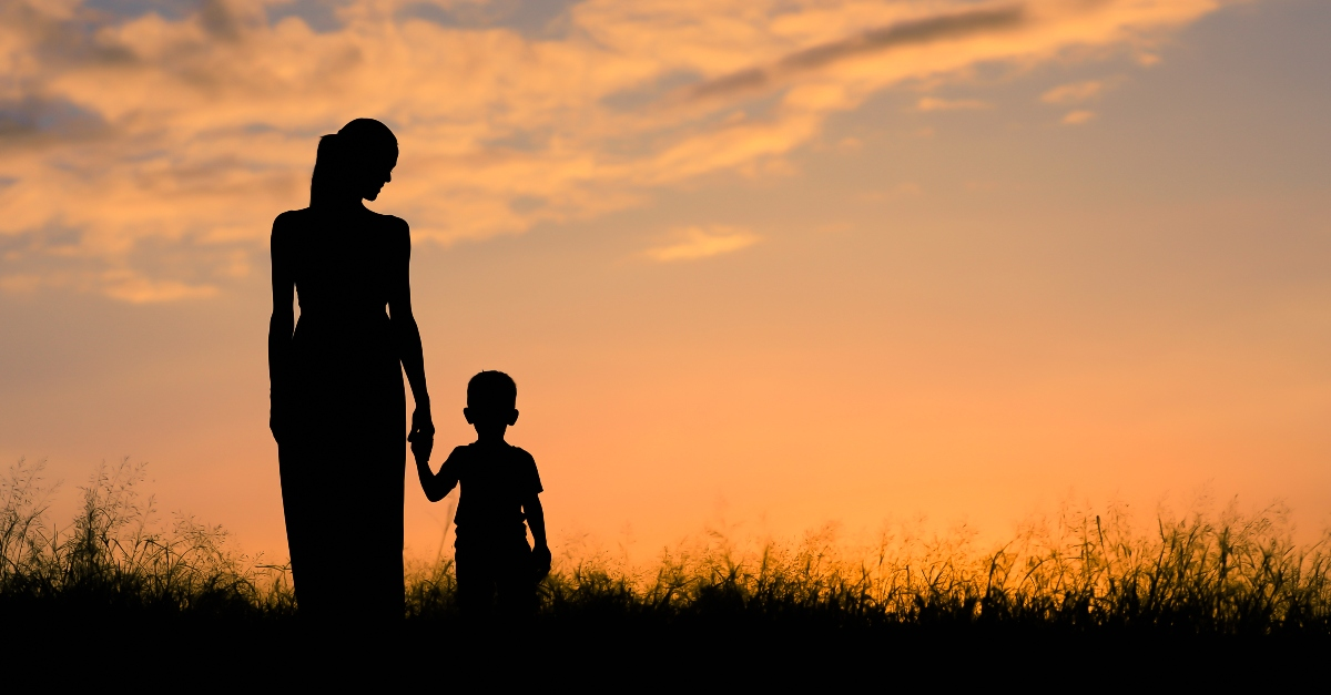 Mother silhouetted with her son