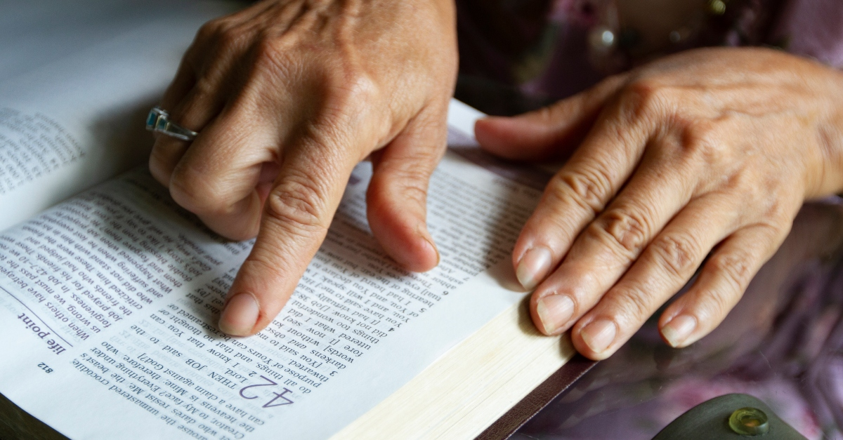 mature senior hand reading bible page, hallmark movies lgbtq