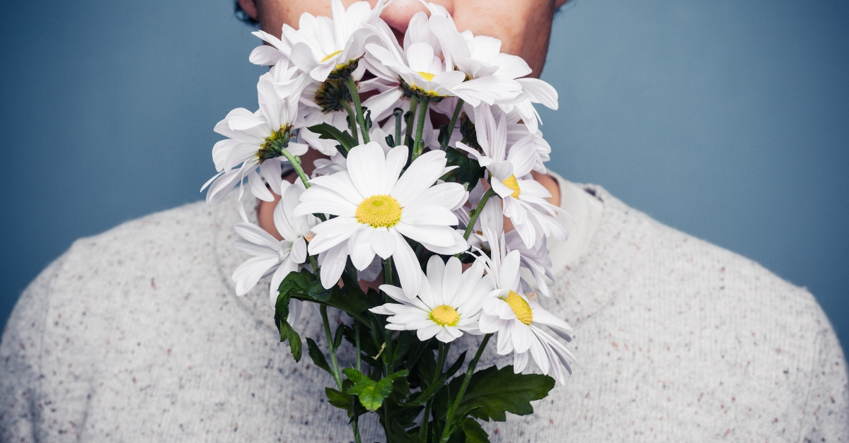 man holding bouquet of flowers close up, who taught you to date