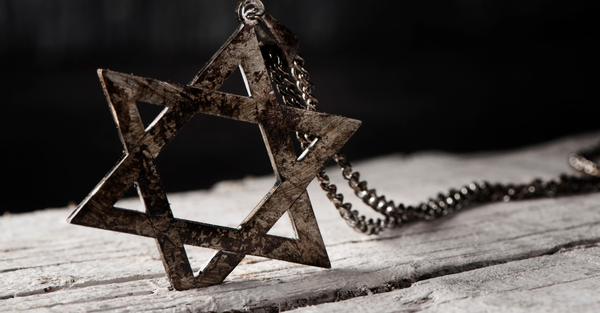 star of David on chain burned to signify holocaust