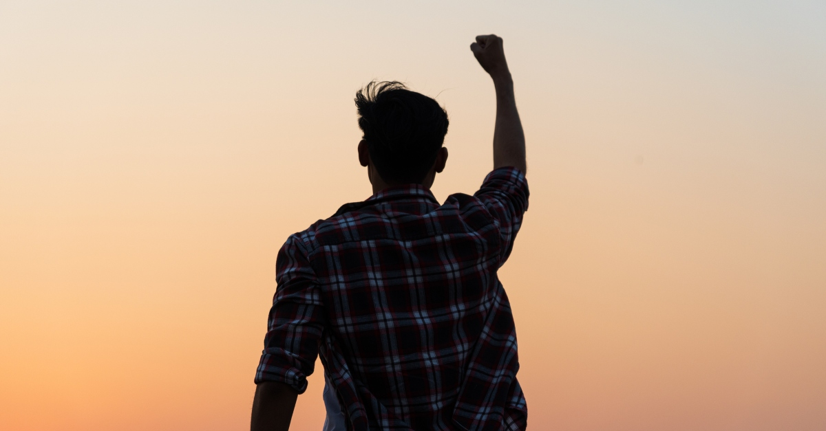 man with fist pump in air in victory God Is My Banner