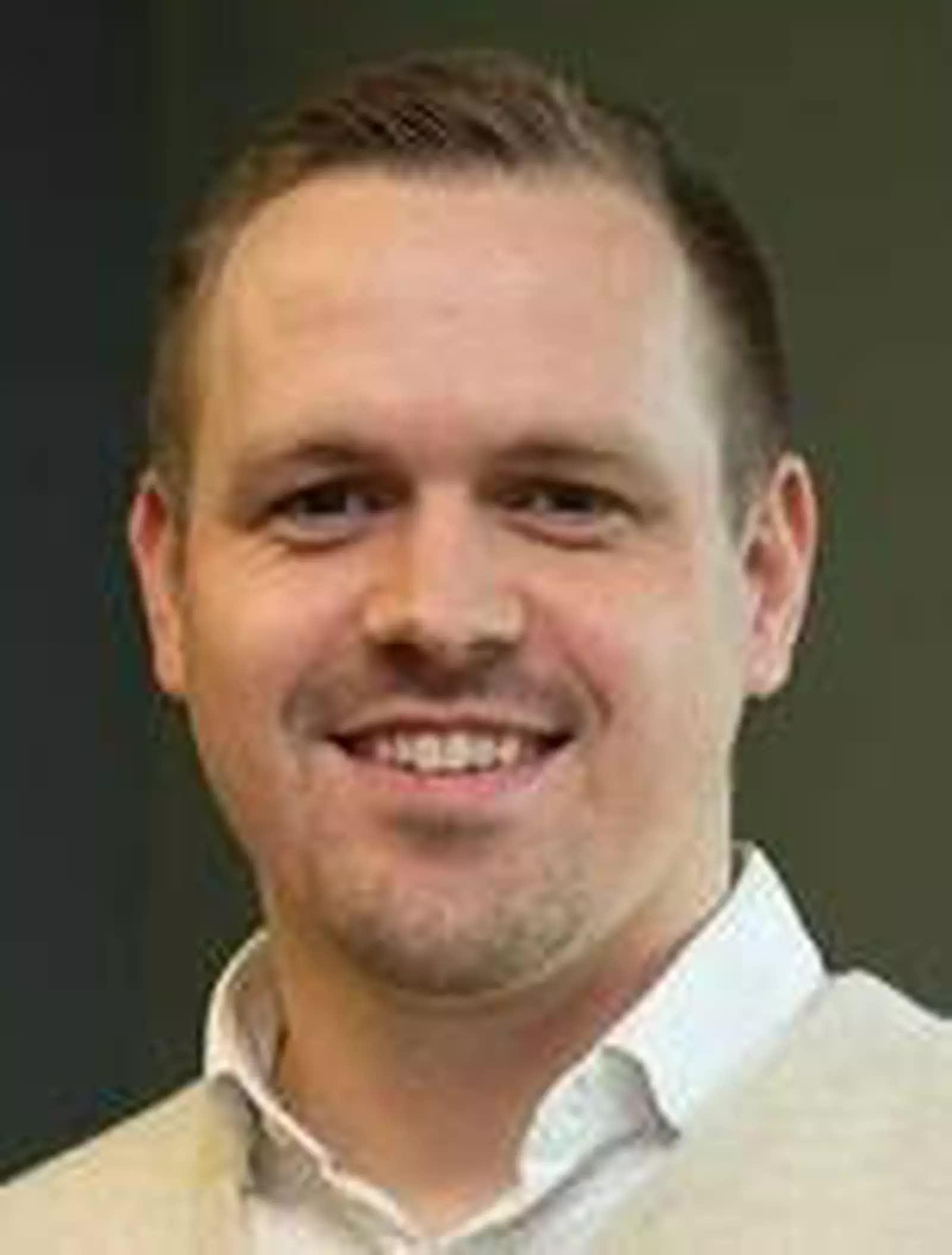 Headshot of author Wade Mullen