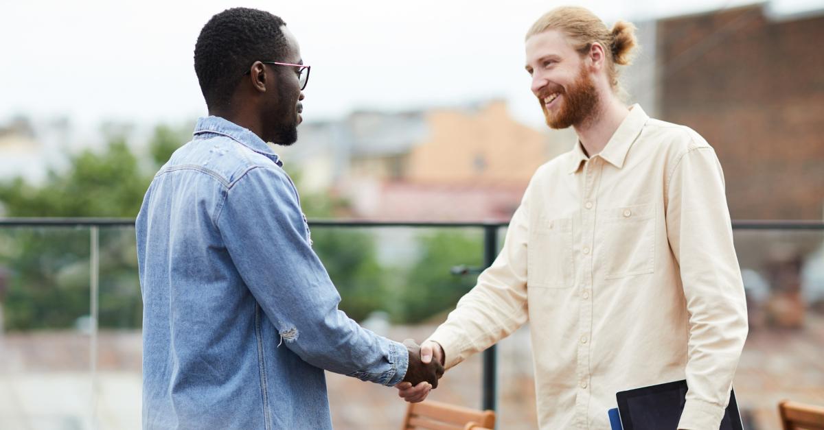 two diverse friends meeting conversation