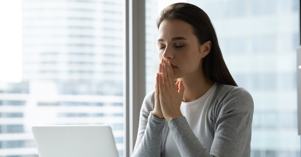 business woman praying for better days ahead