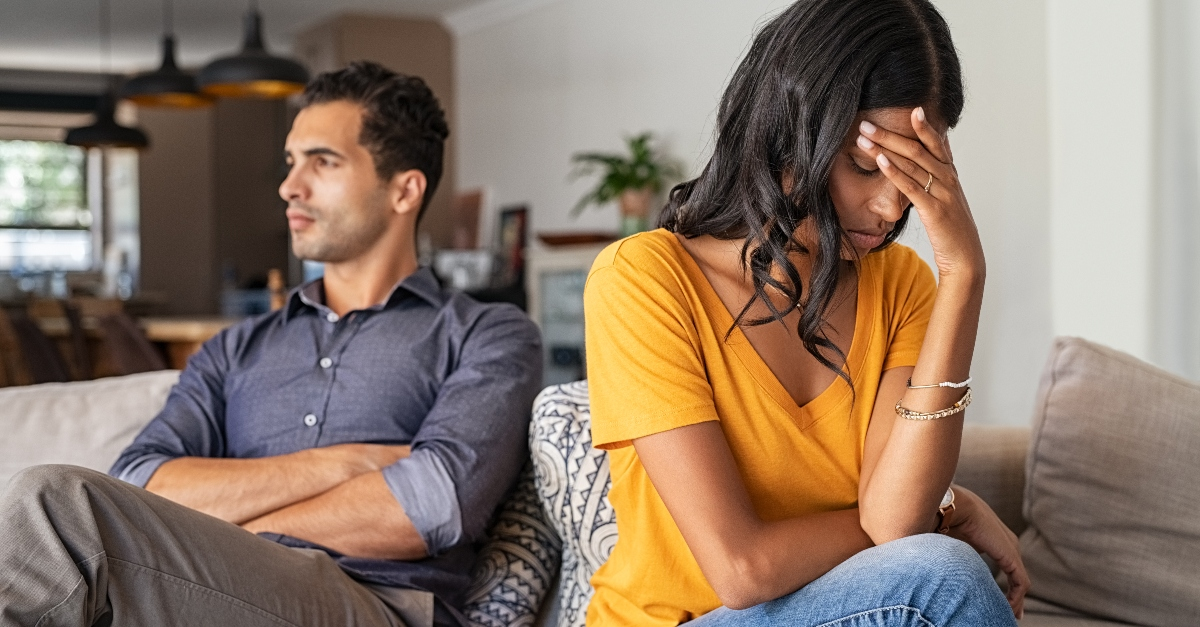 wife and husband upset with each other sitting on couch, when you fear youre not enough for spouse