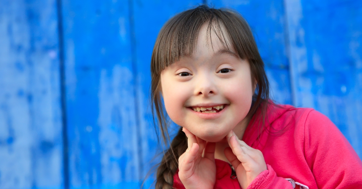 happy girl with down syndrome smiling