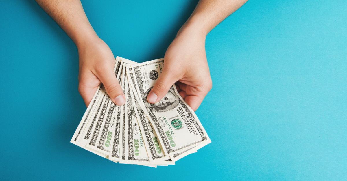 A hand holding money, BLESS foundation raises $1 million for 5 Christians organizations