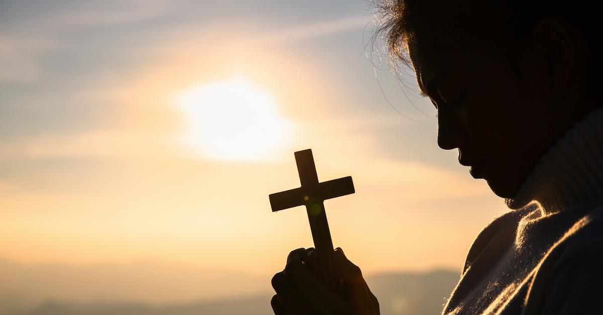 protection prayers, holding a cross in prayer