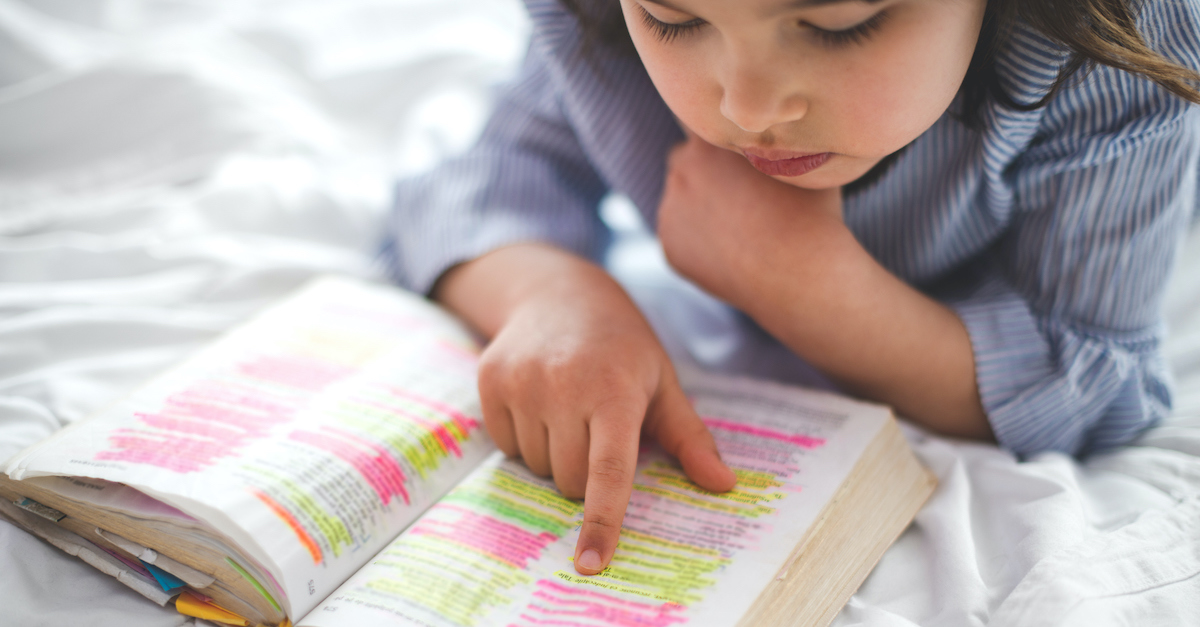 Child reading a highlighted Bible, Bible verses for kids