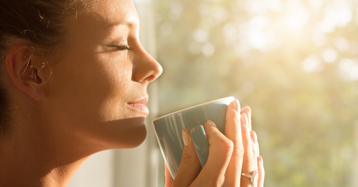 woman drinking morning cup looking peaceful