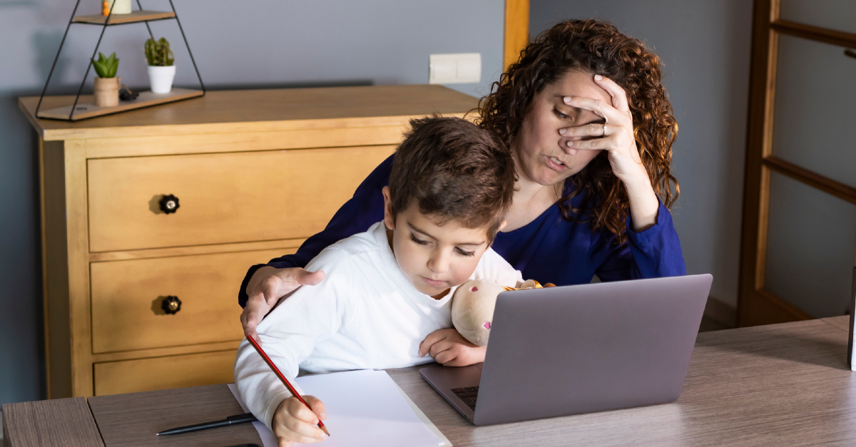frustrated mom homeschooling her child on laptop
