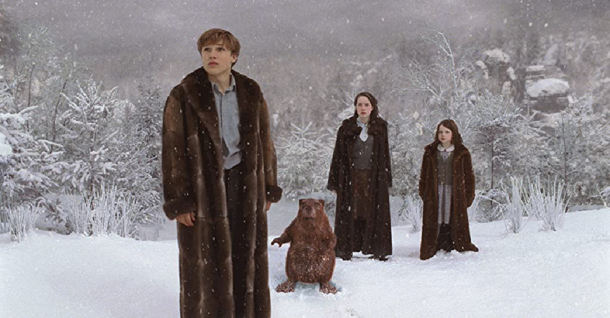 The four siblings in Narnia standing in the snow