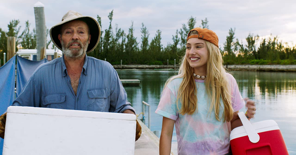 An older man and a young girl fishing in Dolphin Island