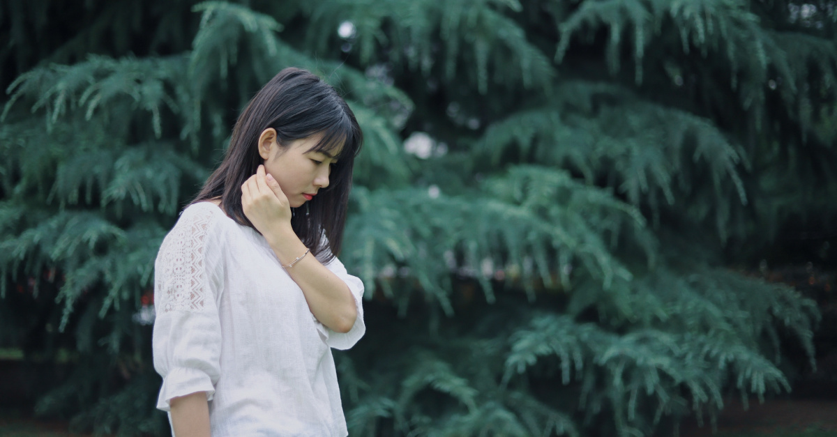 A sad woman looking at the ground, Asian American churches urge people to address hate and racism