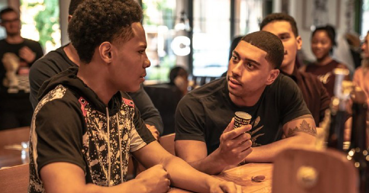 Two young men talking in a cafe in Freshman Year