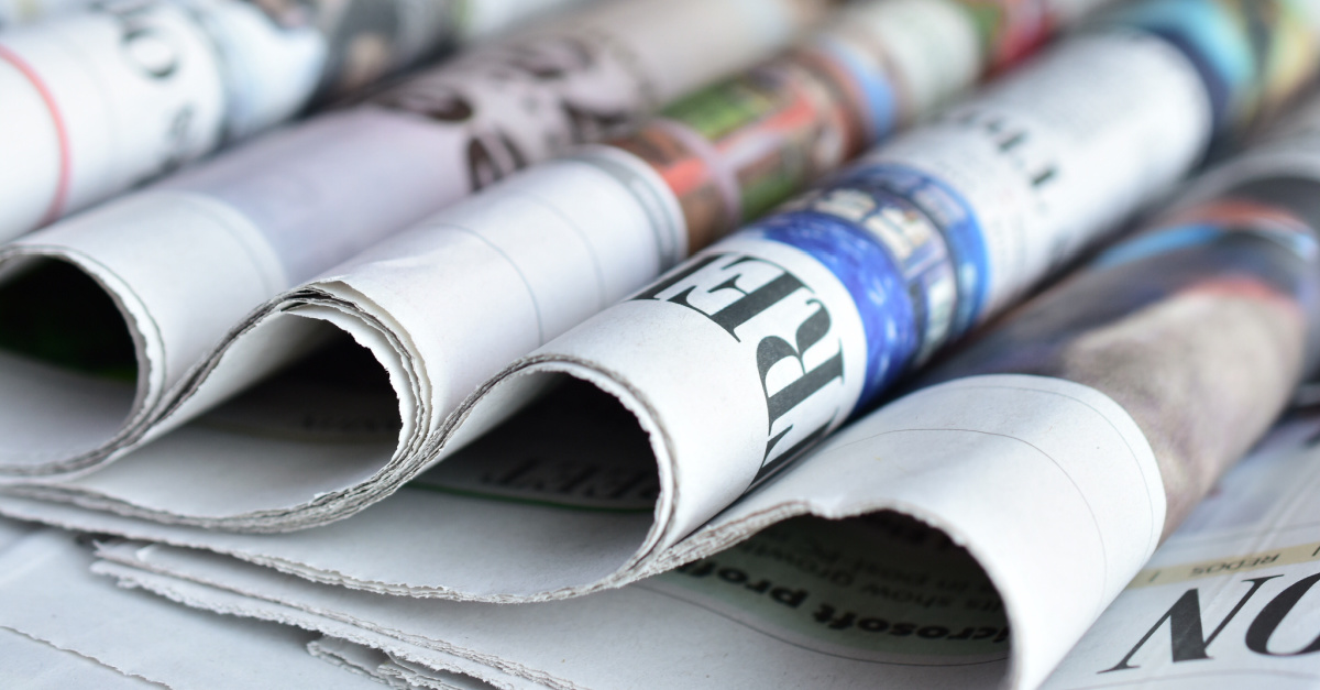 Folded newspapers in a row, USA Today editor is fired