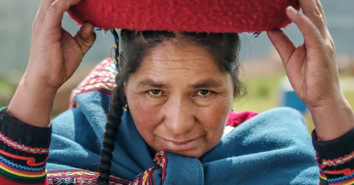 A woman with a pot on her head, Magical Andes still