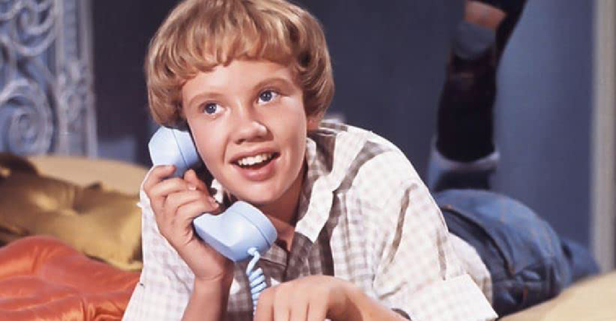 A young person on the phone from Parent Trap
