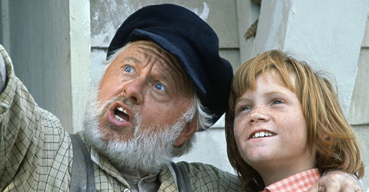 a young boy and older man in Pete's Dragon