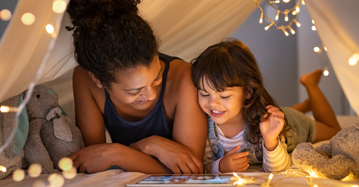 A mother and daughter watching TV, family-friendly movies on Disney Plus