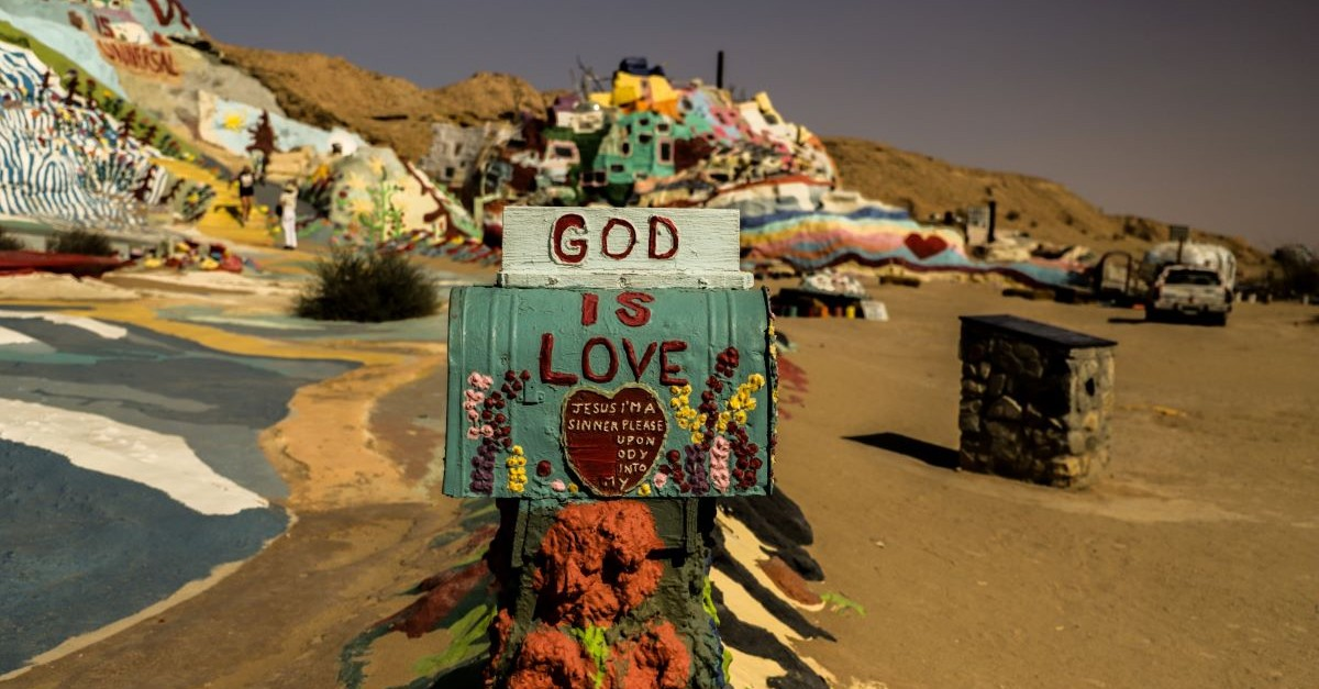 god is love sign rainbow colorful rocks painted