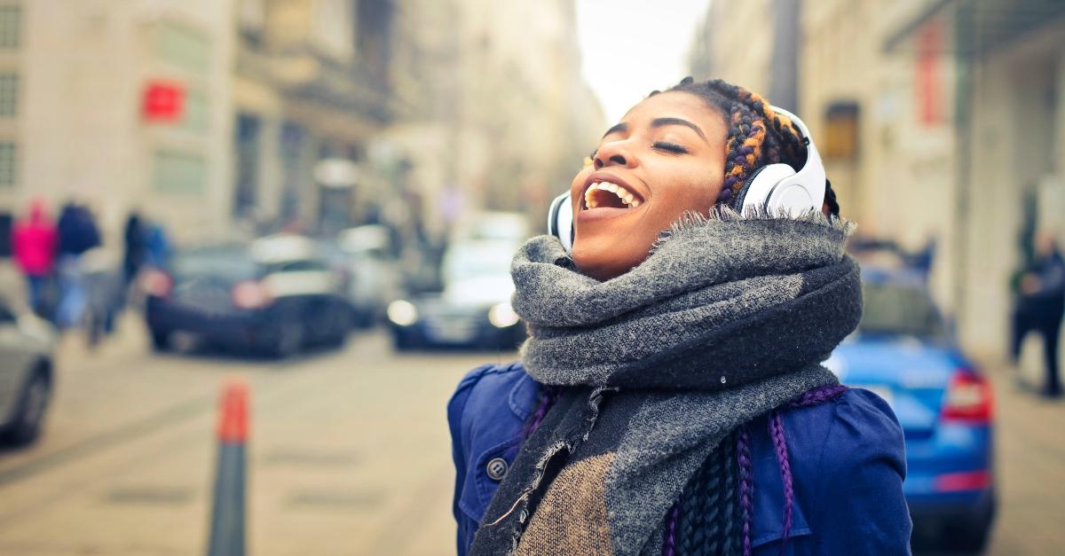 Woman singing while walking down the street