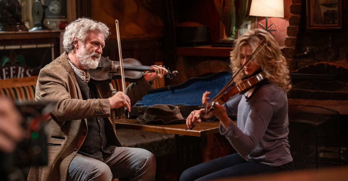 Characters playing violin in Finding You, Its a fun and family-friendly romance