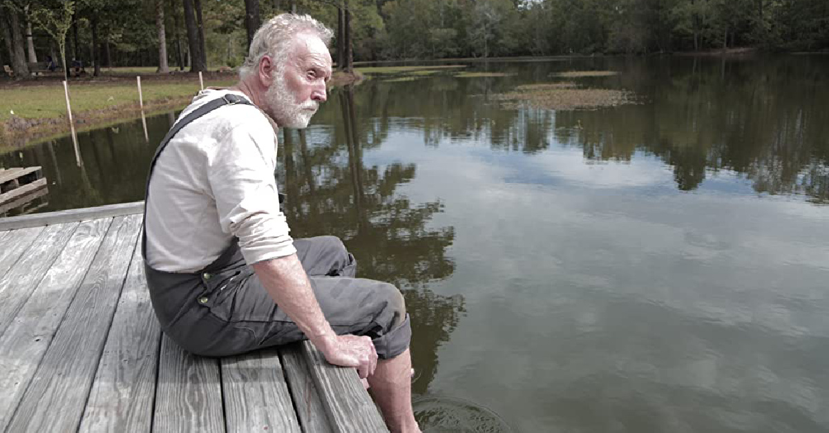 a man sitting on a dock, a new movie about a father's impact