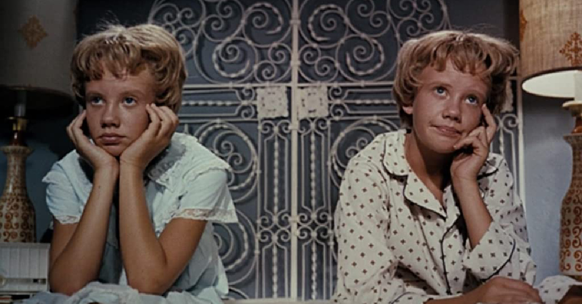 Two identical young girls looking frustrated, The Parent Trap