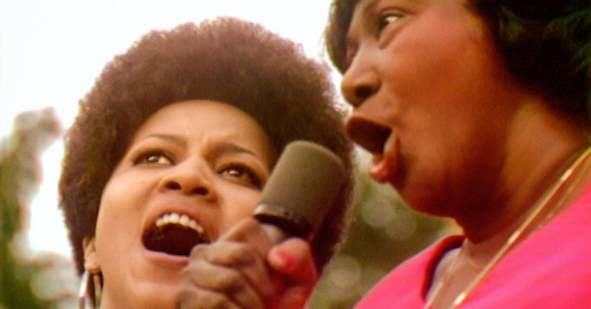 two women singing at the Harlem Cultural Festival, Summer of Soul