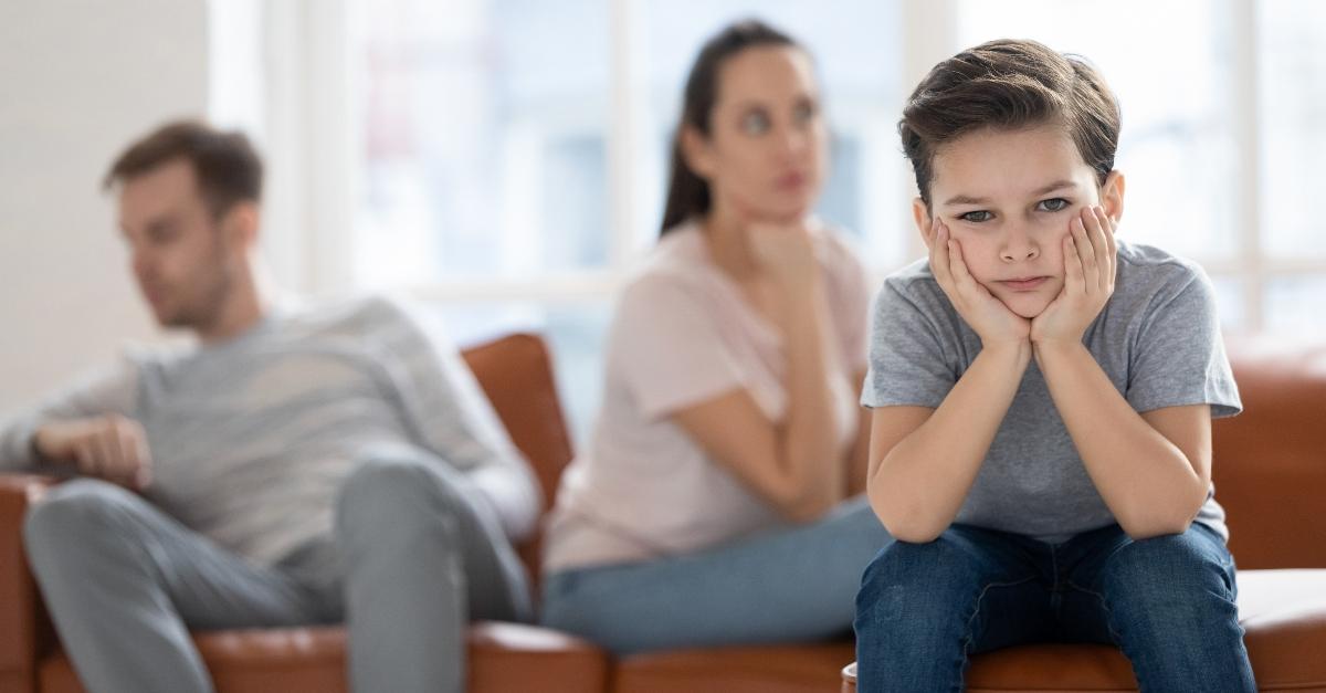 upset kid sitting with parents, grateful heart