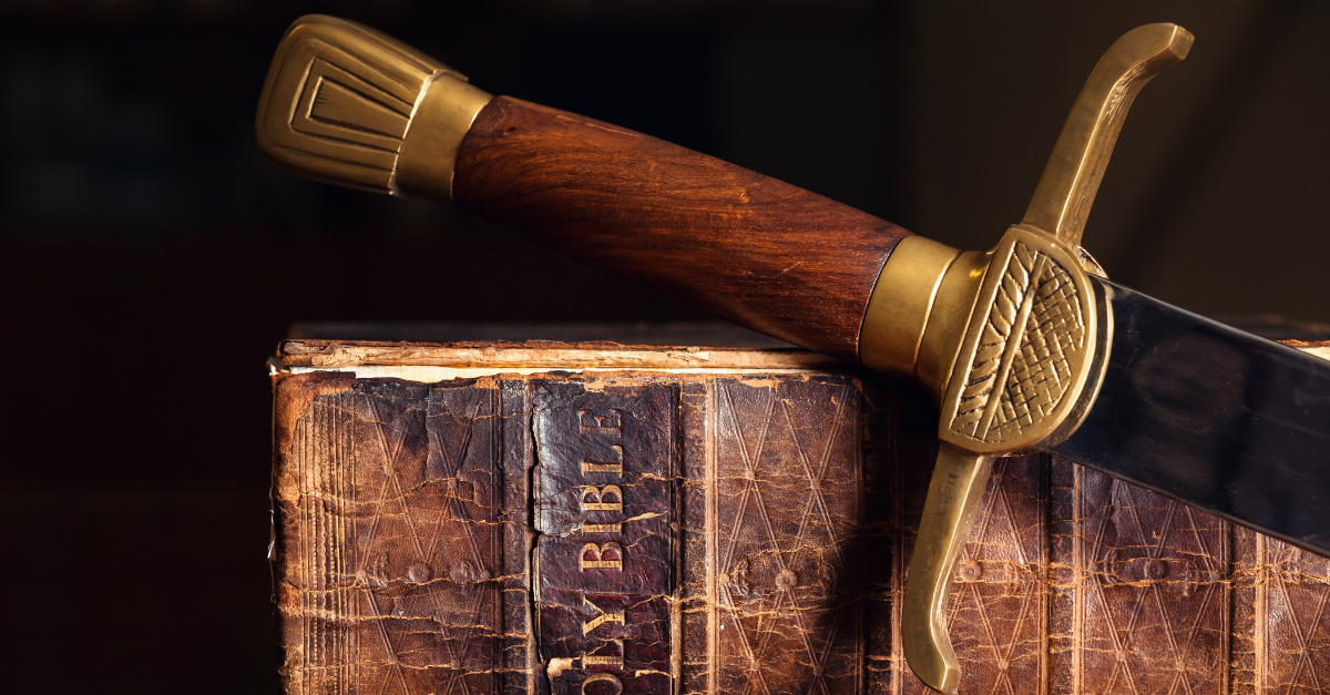 Sword resting on an old Bible
