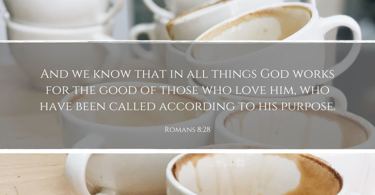 Romans 8:28 written across coffee cup background