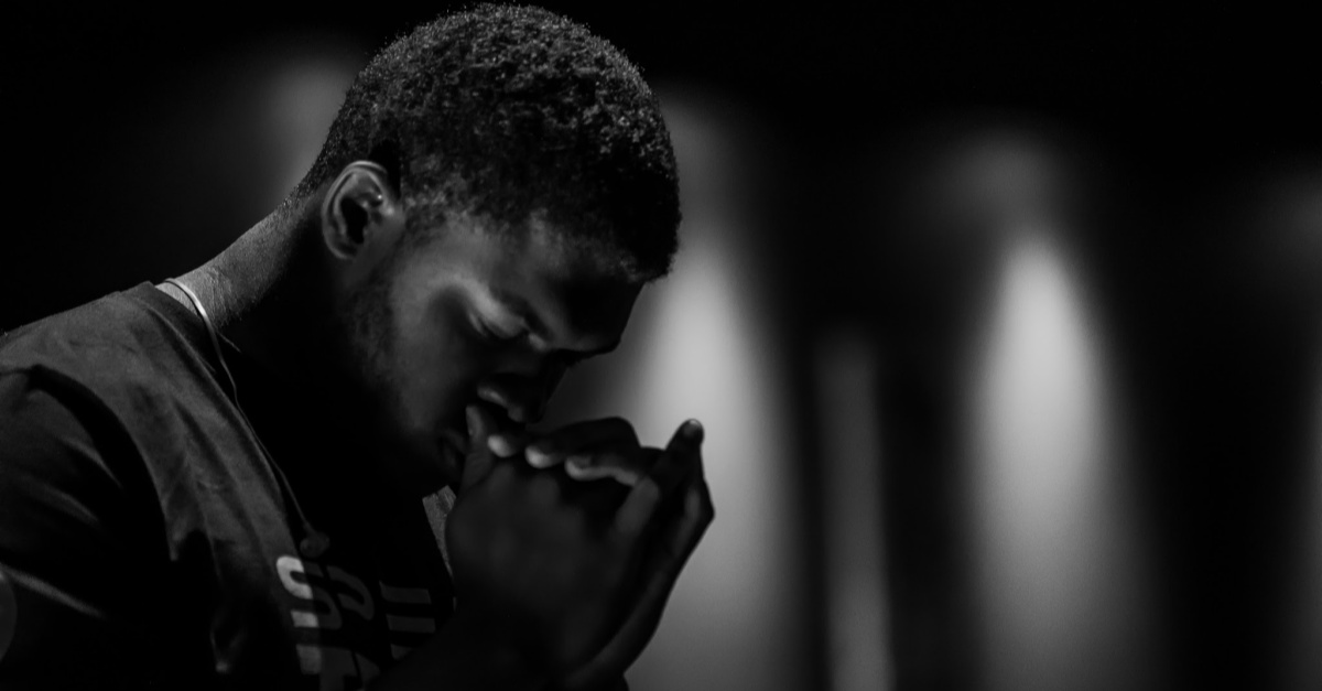 man head bowed praying, what pastors wish you knew about church covid