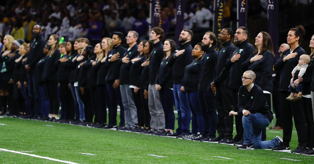 'Teacher of the Year' Kneels in Protest during National Anthem at Championship Football Game Attended By Trump