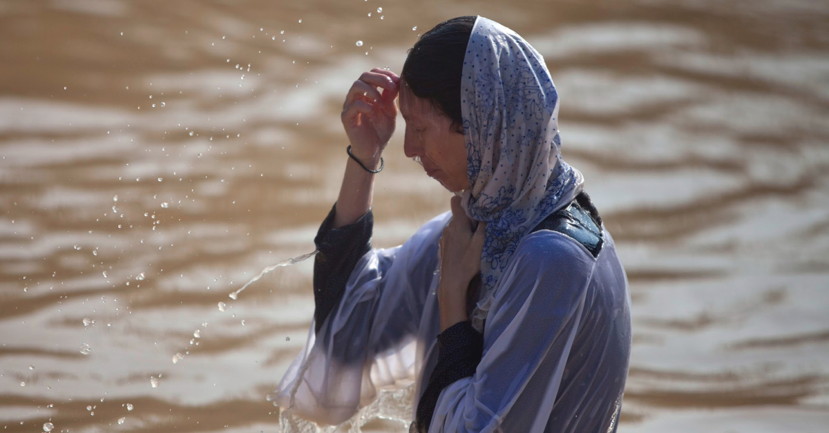 More than 20,000 Orthodox Christians Flock to Jordan River to Be Baptized