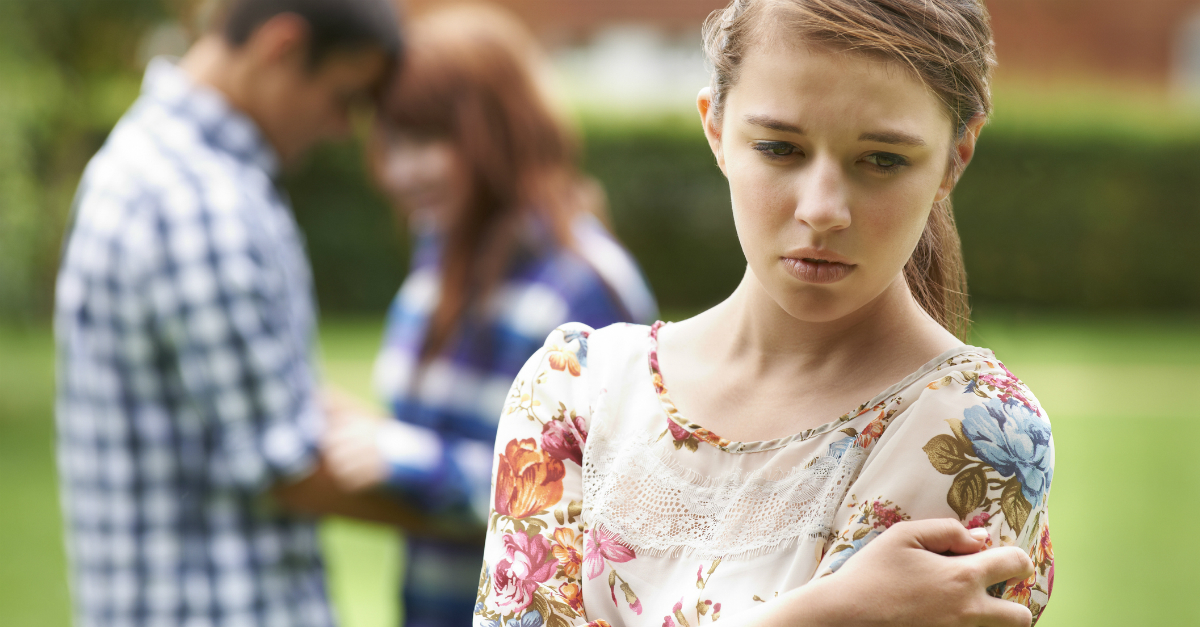 teen girl looking sad left out