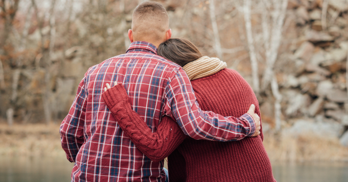 couple hugging the Lord Is Close to the Brokenhearted