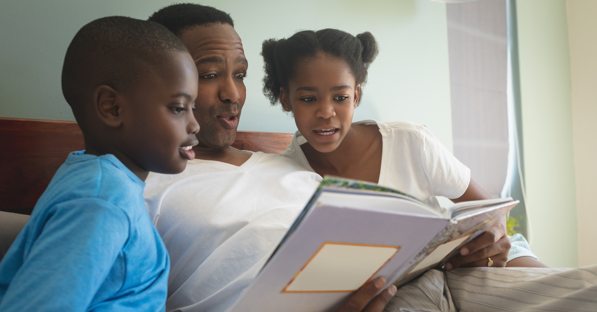 dad reading with children, revitalizing family devotions