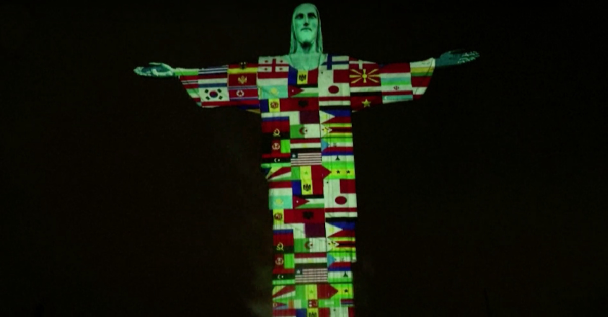Christ the Redeemer Statue Is Lit By International Flags in Tribute to Nations Affected by COVID-19