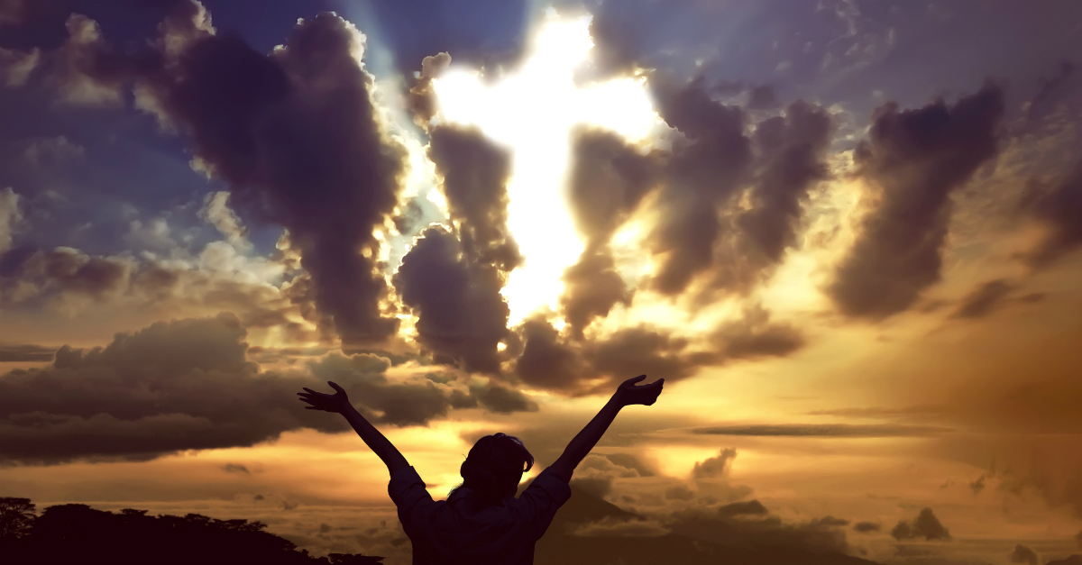 woman arms up in praise to cross in clouds, enter his gates with thanksgiving